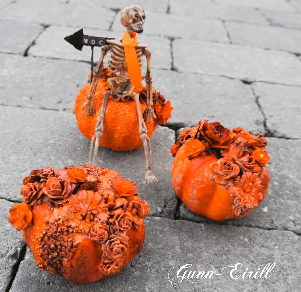 Halloween mini art installation with a skeleton and pumpkins